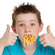 Child with full mouth of fries